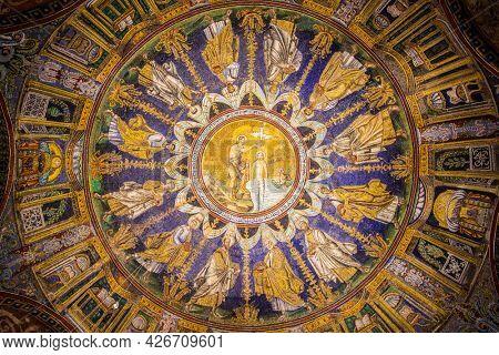 Ravenna, Italy - October 14, 2016: Mosaic cupola in the Neoniano Baptistery in Ravenna - John the Baptist baptizing Jesus and the Apostles around, cerca 5th century