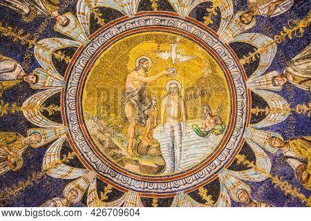 Ravenna, Italy - October 14, 2016: John the Baptist baptizing Jesus - mosaic on the ceiling in the Neoniano Baptistery in Ravenna (cerca 5th century)