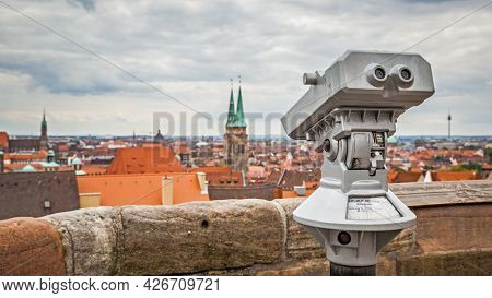 Nuremberg, Germany - May 17, 2016: Panoramic view of the old town from viewing point in Nuremberg with touristic telescope