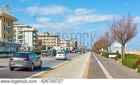 Rimini, Italy - February 25, 2020:  Giuseppe di Vittorio street alond the sea with hotels and beaches in Rimini , Emilia-Romagna