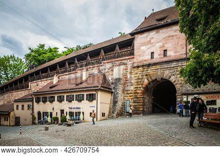 Nuremberg, Germany - May 17, 2016:  Street in the old town of Nuremberg near city walls