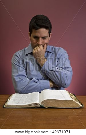 Man Contemplates While Reading The Word