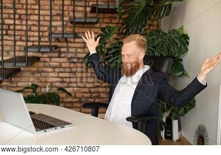 Happy Male Office Employee In Formal Wear Raising Fists In Triumph, Celebrate Good News, Received Un