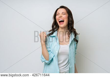 A Happy, Excited Woman, Rejoices At The Good News, Actively Gestures With Happiness.