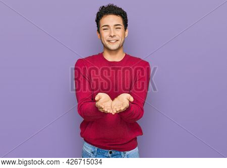Young handsome man wearing casual clothes smiling with hands palms together receiving or giving gesture. hold and protection