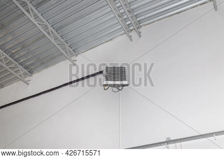 Industrial Heater, Hanging On The Wall Of The Hall, Used For Air Heating And For Cooling With Cold W