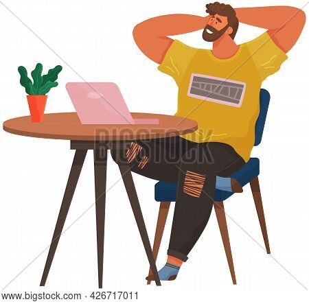 Happy Man Chilling On His Working Place. Relaxed Guy Sitting On Chair Feeling Satisfied From Work Pr