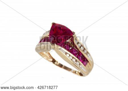 Yellow Gold Ring With Rubies And Diamonds, Isolated On A White Background