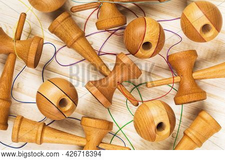 Background From Wooden Childrens Toys Kendama, Top View