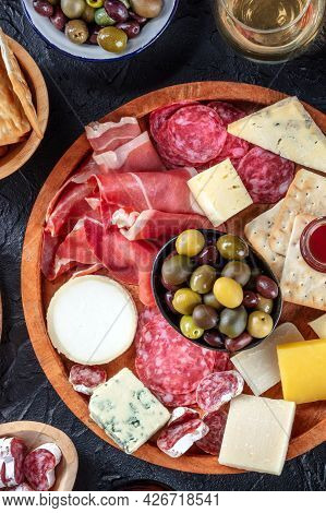 Italian Antipasti Or Spanish Tapas With Wine. Gourmet Charcuterie And Cheese Board, Shot From Above
