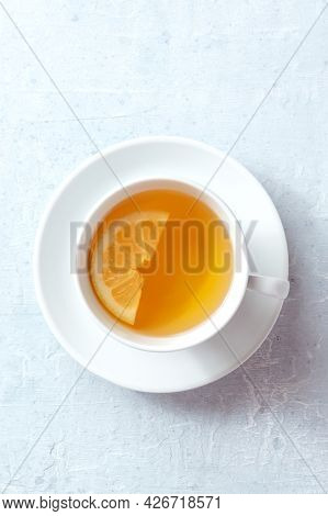 Tea With Lemon, Overhead Shot Of A Plain White Cup On A Table. Natural Remedy. Soothing Citrus Drink