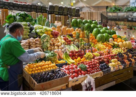 Assortment Of Fresh Organic Vegetables And Fruits At The Farmers Market, Open Shelves, Display Cases