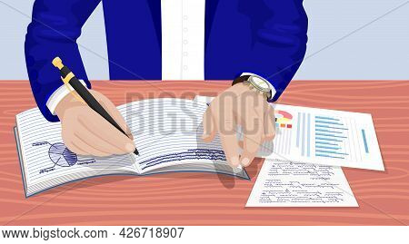 Businessman In Suit Sitting At Table, Writing With Pen, Works And Draws Pie Chart In Notebook. Busin