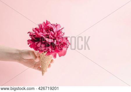 Wafer Cup For Ice Cream With A Peony Flower In A Woman's Hand. Summer And Summer Gifts Concept