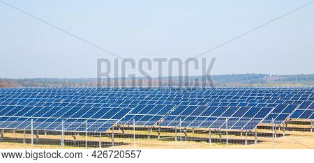 Electric solar panel Farm with solar electric panels on a green field