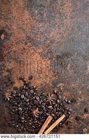Roasted Coffee Beans, Cinnamon Sticks, Star Anise Scattered On The Table With Copy Space. Vertical V