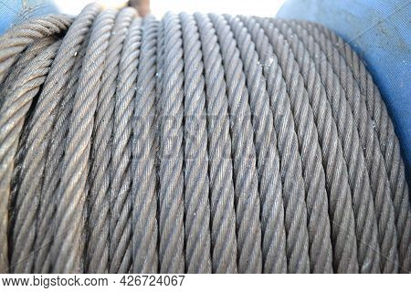 Industrial Winch Coil With A Metal Wound Steel Cable And Tightly Pressed Together.