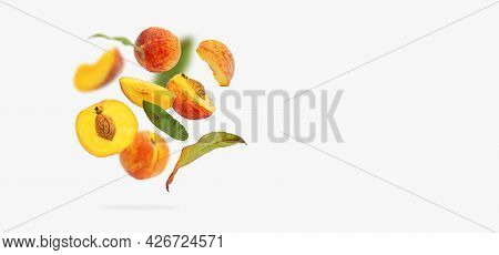 Flying Fresh Ripe Juicy Peaches With Green Leaves Isolated On Gray Background. Whole And Halved Peac