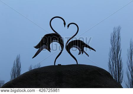Two Swans Stand On A Heart-shaped Stone. Mother's Day Card, Valentine's Day Valentine's Day