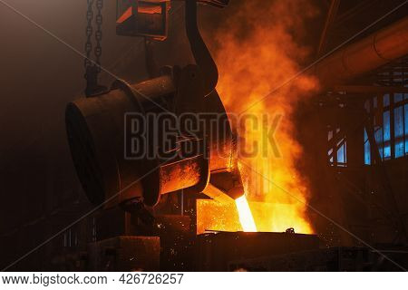Molten Metal Casting. Pouring Iron With Smoke And Sparks. Metallurgical Plant. Steel Production. Fou