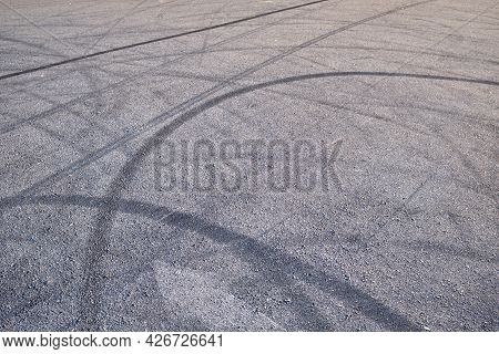 Tire Marks On The Asphalt, Black Tire Tracks Skid On Asphalt Road. Tyre Burnout Marks On Asphalt Roa