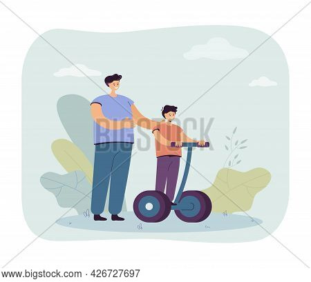 Father Standing Next To Son Riding Modern Personal Transporter. Man Helping Boy With Electric Vehicl
