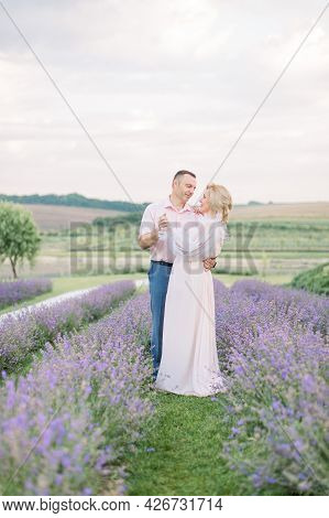 Photo Of Beautiful Middle Aged Couple, Handsome Man And Elegant Pretty Blond Lady, Dating And Walkin