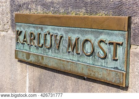 Copper Sign With The Name Of The Charles Bridge (karluv Most) In Prague, Czech Republic