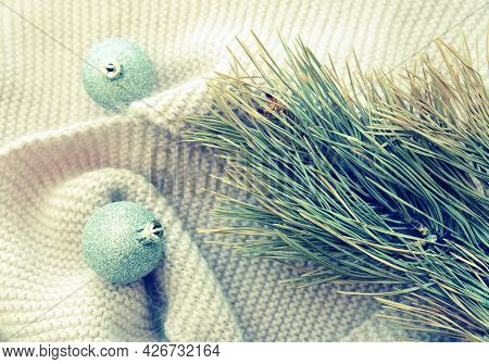 Festively Decorated Christmas Shiny Balls And Pine Branch On Knitted Fluffy Blanket, Retro Toned, Wi