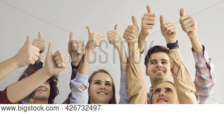 Group Of People Giving Thumbs-up Showing Their Satisfaction And Positive Attitude