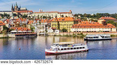 Prague, Czech Republic - September 13, 2020: Tourist Cruise Boat On The River Moldau In Historic Cit