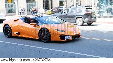 Los Angeles, California Usa - April 11, 2021: Orange Lamborghini Aventador On Road In La. Side View