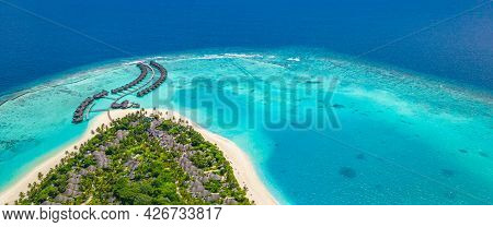 Aerial Top View On Sand Beach, Palm Trees And Luxury Water Villas Bungalows. Exotic Summer Travel La