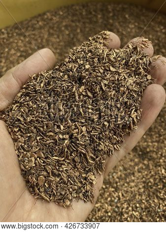 Handful Of Copper Granules From Cable Recycling Plant.