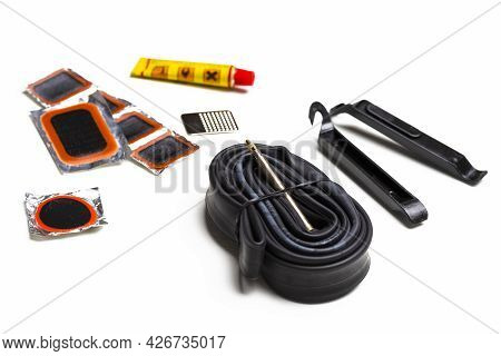 Road Cycling Concepts. Complete Set Of Road Bike Inner Tube Repairing Kit Against White.horizontal S