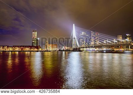 Travel Concepts. Tranquil Night View Of Renowned Erasmusbrug (swan Bridge) In  Rotterdam In Front Of