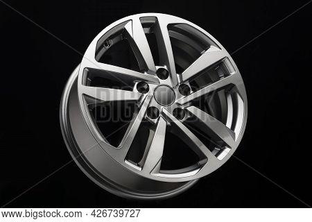 Grey Modern Alloy Wheel Side View On Black Background