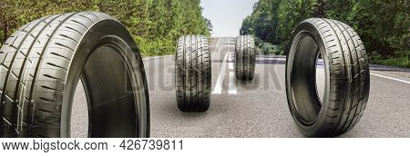 Summer Tires Roll On The Asphalt Road. The Season Of Changing Tires