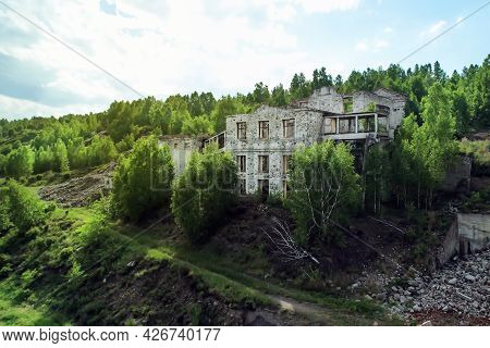 An Abandoned Mine In The Woods. Old Ruined Building In Nature, Aerial View Drone