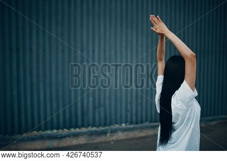 Asian Young Woman Doing Qigong Exercise Summer Outdoor.