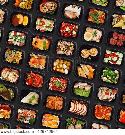 Different Healthy Take Away Meals In Plastic Containers Over Black Background