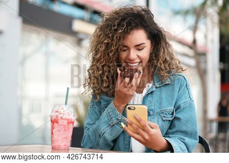 Latin Woman Using A Mobile Phone While