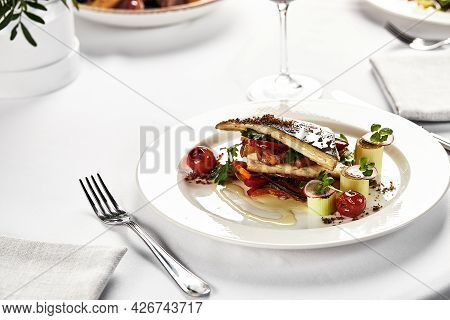 Grilled Sea Bass With Fried Tomatoes, Close-up Of Grilled Fish On A Light Plate, Grilled Sea Bass Wi