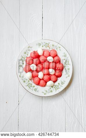Watermelon Salad With Mozzarella Cheese On White Vintage Plate. Caprese Salad With Watermelon Balls