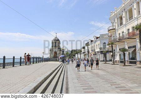 Yalta, Crimea, Russia - May 29, 2021: Yalta Embankment With Walking Tourists.