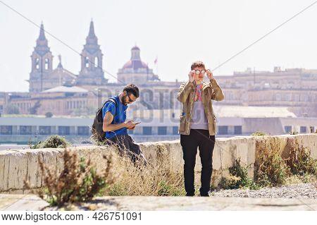 Two Adult Guys Against Of Valletta Skyline From Manoel Island Side In Gzira: Manoel Island, Gzira, M