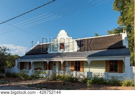 Prince Albert, South Africa - April 20, 2021: A Street Scene, With A Cape-dutch House, In Prince Alb