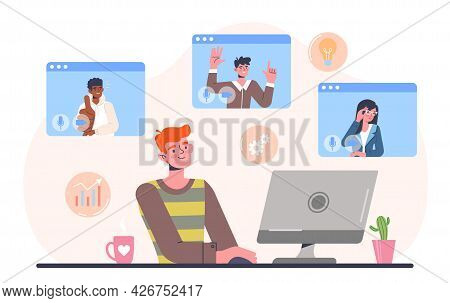 Telecommuting Concept. The Man Is Sitting At Home And Communicating With Colleagues Via Video Link.