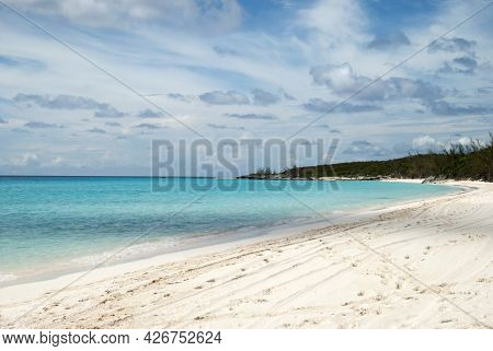 The View Of Half Moon Cay Empty Beach And Turquoise Color Waters Of Caribbean Sea (bahamas).