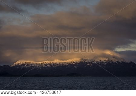 Morning Sun Over Clouds Flying Over Andes Mountain Peaks In A Little Island In Ushuaia, Tierra Del F